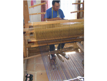 Miguel working the foot loom 09
